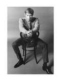 10 Years - People; Actor James Coburn, Seated Backwards on a Chair Regular Giclee Print