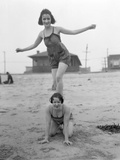 Two Young Women Playing on Beach Photographic Print