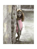 Young Girl Standing Against a Stone Wall Giclee Print by Nora Hernandez