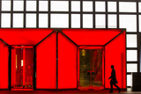 China, Beijing, Silhouette of Shopper Walking Past Shopping Mall Photographic Print by Paul Souders