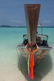 Thailand, Phuket, Island of Phi Phi Don. Traditional Longboat Fotodruck von Cindy Miller Hopkins