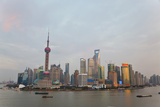 Barges and Pudong Skyline, Sunset, Shanghai, China Fotografie-Druck von Peter Adams