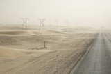 Namibia, Namib Desert, Walvis Bay. Desert Road in a Sandstorm Photographic Print by Wendy Kaveney