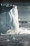 Antarctica. Iceberg at Sunrise Surrounded by Sea Ice Photographic Print by Janet Muir