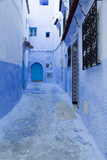 Morocoo, Chefchaouen, a Fountain Stands in a Town Square Photographic Print by Emily Wilson