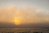 Sunset Light Shining Through Fog Bank of the Florida Coast Photographic Print by James White