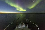 Canada, Nunavut, Aurora Borealis Glows in Night Sky Above Hudson Bay Photographic Print by Paul Souders