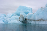 Norway. Svalbard. Brasvelbreen. Turquoise Ice Bergs in the Calm Water Photographic Print by Inger Hogstrom