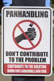 Ft. Lauderdale, Florida. Sign to Discourage Giving to Panhandlers Photographic Print by Charles O. Cecil