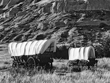 Nebraska, Scotts Bluff National Monument. Covered Wagons in Field Photographic Print by Dennis Flaherty