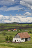 Romania, Transylvania, Tarnaveni, Farm and Fields, Spring Photographic Print by Walter Bibikow