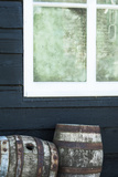 Rustic Barrels Lined Up Along an Old House Below a Window Photographic Print by Sheila Haddad