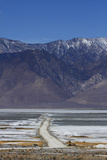 Road across Owens Lake and Sierra Nevada Mountains, California Photographic Print by David Wall