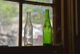 USA, Arizona, Jerome, Gold King Mine. Old Bottles in a Window Photographic Print by Kevin Oke
