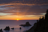 Sunset over Seastack and Ecola State Park Near Cannon Beach, Oregon Photographic Print by Brian Jannsen