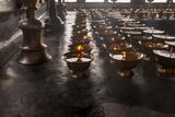 Buddhist Prayer Candles Photo by Howie Garber