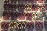 Myanmar. Mandalay. Maha Aung Myae Bone San Monastery. Lines of Shoes Photo by Inger Hogstrom