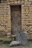 Old Doorway, Traditional Village of Xingping with Broom in Front Photo by Darrell Gulin