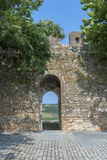 Portugal, Obidos, View of Farm Through Battlement Opening in Courtyard Photo by Lisa S. Engelbrecht