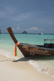 Thailand, Phuket, Island of Phi Phi Don. Traditional Longboat Photo by Cindy Miller Hopkins