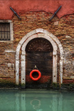 Doorway Along Canal with Safety Buoy Venice, Italy Photo by Darrell Gulin