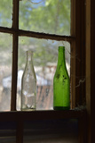 USA, Arizona, Jerome, Gold King Mine. Old Bottles in a Window Photo by Kevin Oke