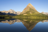 Glacier NP. Morning at Swift Current Lake Reflects Grinnell Point Photo by Trish Drury