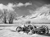 USA, California, Bishop. Snow-Covered Vintage Wagon in Owens Valley Photo by Dennis Flaherty
