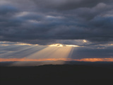 Crepuscular Rays Breaking Out from Behind a Cloud Photo by Greg Probst