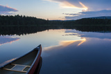A Canoe on Little Berry Pond in Maine's Northern Forest. Sunset Photo by Jerry & Marcy Monkman