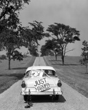 1950s Back of White Ford Sedan Driving Off with Just Married Sign Photo