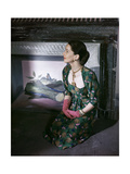 Model Kneeling in Front of Vertes Mural in Fireplace Wearing Green and Pink Print Dress Photographic Print