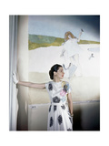 Model Standing before Mural by Vertes Wearing Floral Print on White Rayon Crepe Dress Regular Photographic Print