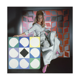 Model Surrounded by Artworks by Vasarely Wearing Staron Silk Matelasse Evening Robe by Stella Regular Photographic Print