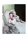Model Reclining in a Chair Wearing Beige Dress of Slubbed Italian Silk with a Satin Closing Photographic Print
