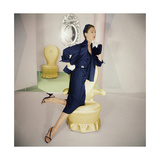 Model Resting Knee on Yellow Armchair Wearing Navy Blue Silk Satin Jacket with Wide Lapel Regular Photographic Print