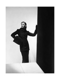 Model Wearing Cylinder-Silhouette Astrakhan Coat with Rolled Funnel Collar Photographic Print