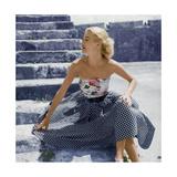 Model Sunny Harnett Wearing Strapless Floral Top with Black-White Checked Full Skirt Photographic Print