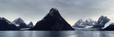 A Cone-Shaped Mountain Rises from the Dark Waters of an Arctic Fjord Beneath a Storm Laden Sky Photographic Print by Jason Edwards