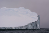 An Iceberg in Ilulissat Icefjord, an UNESCO World Heritage Site, on a Cloudy Day Photographic Print by Sergio Pitamitz