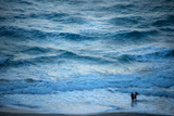 A Couple Plays in the Ocean Waves at Dusk at Riviera Beach Reproduction photographique par Joel Sartore