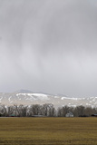 A Spring Storm Hovers over the Gallatin Valley, Near Bozeman, Montana Photographic Print by Gordon Wiltsie