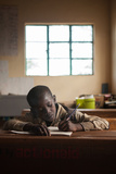 A Young Boy Studies at a School in Daaba, Kenya Built by an American Non-Profit Photographic Print by Greg Davis
