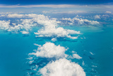 An Aerial View Above the Clouds over the Turquoise Waters of the Caribbean Sea, Near the Bahamas Photographic Print by Mike Theiss