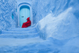 A Man Rests in the Blue-Walled City of Chefchaouen, Morocco Photographic Print by Greg Davis