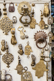 Assorted Brass Door Knockers for Sale in the Medina of Fez Photographic Print by Richard Nowitz