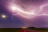 An Intense Lightning Storm over Fields and a Road in South Dakota Fotografisk tryk af Mike Theiss