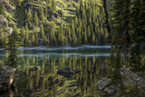A Beautiful Alpine Lake Glows in the Morning Light, Deep in the Swan Mountain Range Photographic Print by Ami Vitale