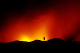 Standing on the Crust of an Active Lava Flow, Watching Lava Flow into the Pacific, Kilauea Volcano Photographic Print by Cagan Sekercioglu