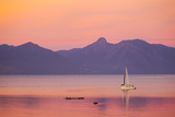 A Sailboat in Lake Villarrica's Flat Calm Water with Small Ripples, at Sunset Photographic Print by Mike Theiss
